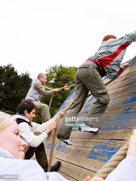 Young people in an assault course.