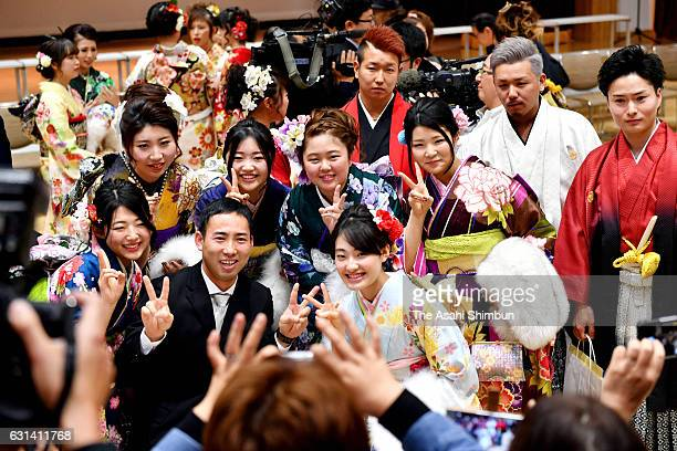 Young people in colorful kimono and other attire pose for a commemorative photo after ComingofAge ceremony on January 8 2017 in Iitate Fukushima...
