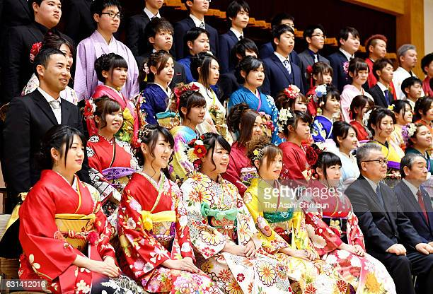 Young people in colorful kimono and other attire pose for a commemorative photo during ComingofAge ceremony on January 8 2017 in Iitate Fukushima...