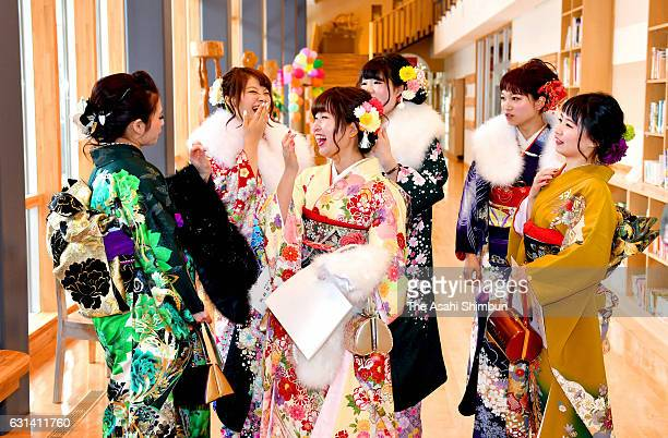 Young people in colorful kimono chat during ComingofAge ceremony on January 8 2017 in Iitate Fukushima Japan Iitate remains one of the most heavily...