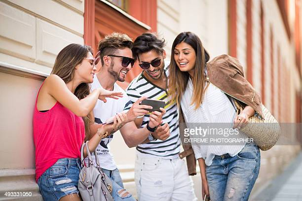 Young people in the street with mobile phone