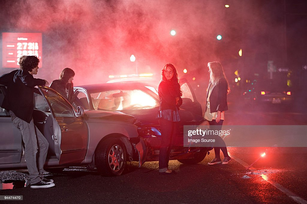Young people involved in car crash : Stock Photo
