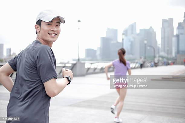 Young people jogging in city, Shanghai, China