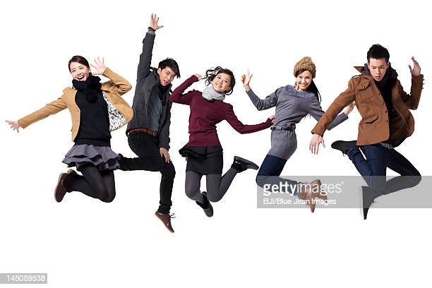 Young people jumping in mid-air