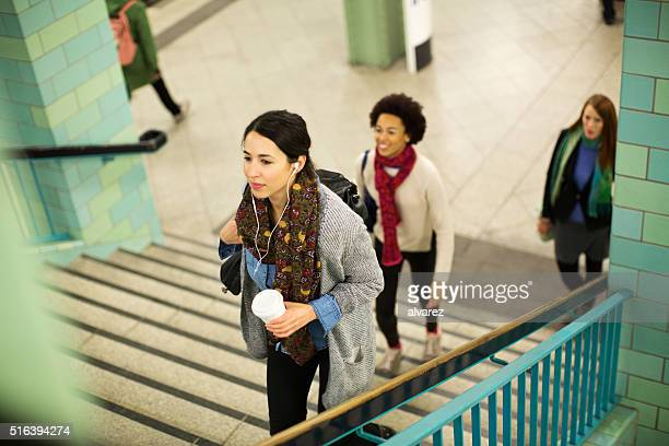 Young people leaving subway station