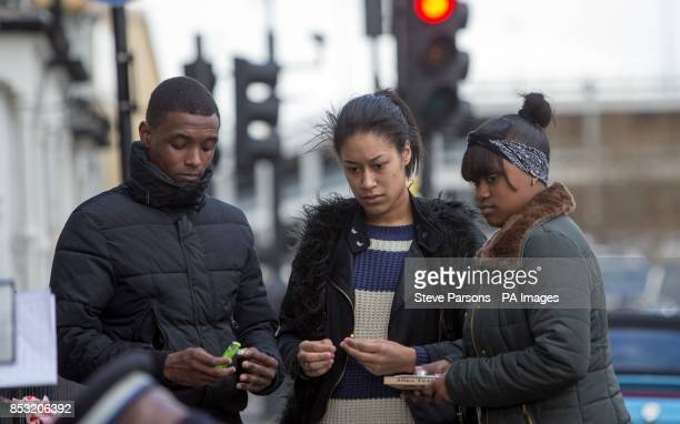 Young people light candles at the scene in Eastway Hackney east London where a teenage girl named as Shereka Marsh died after a shooting yesterday as...