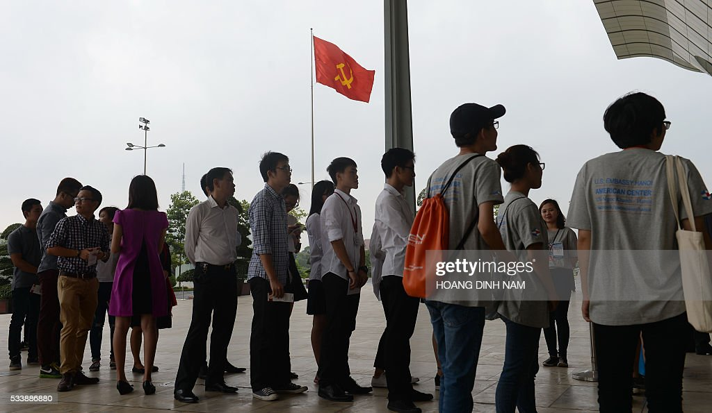 Young people line up to enter the National Convention Center where US President Barack Obama will deliver a live-broacast speech in Hanoi on May 24, 2016. US President Barack Obama told communist Vietnam on May 24 that basic human rights would not jeopardise its stability, in an impassioned appeal for the one-party state to abandon authoritarianism. / AFP / POOL / HOANG