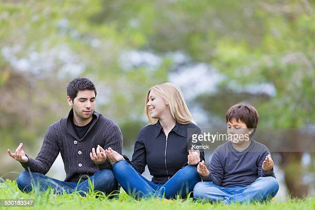 young people meditation in the morning in a park