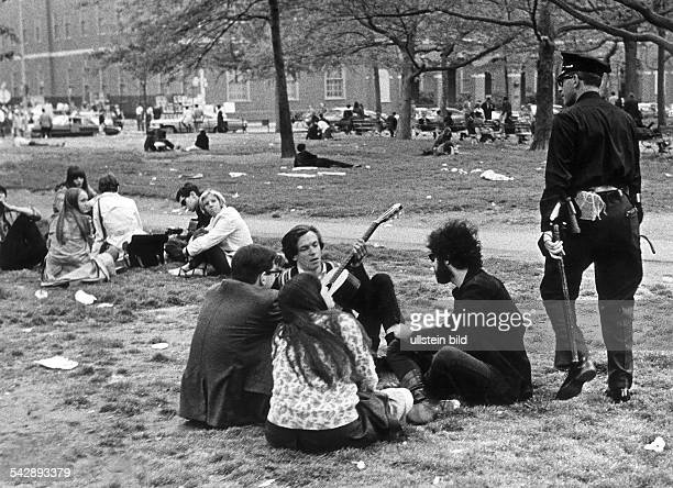 GREENWICH VILLAGE 1969 Young people meeting in Washington Square Park New York City 1969