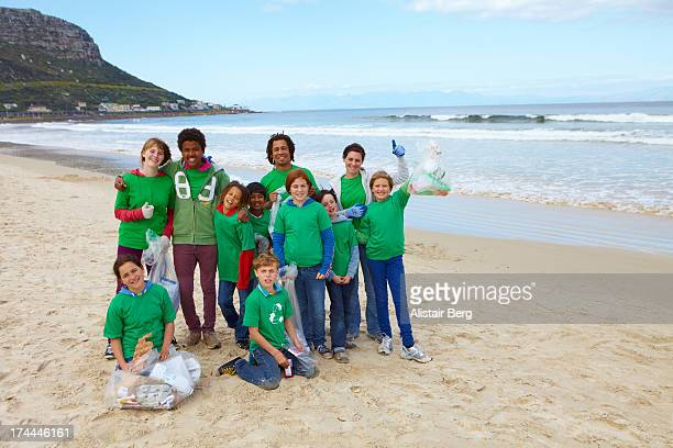 Young people on a beach clean up