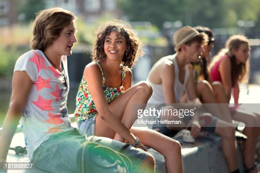 Young people on top of canal boat