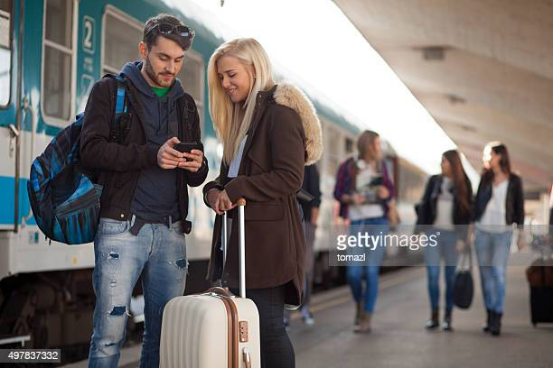 Young people on train station