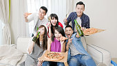 young people eat pizza and drink beer with party