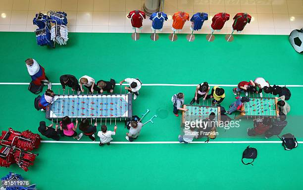 Young people play table football in a shopping center on June 10 2008 in Fribourg Switzerland
