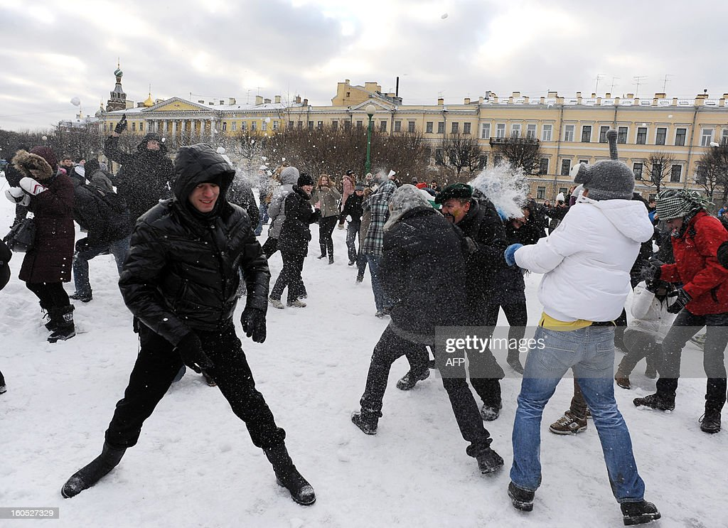Young people play with snowballs as they take part a flash mob 'snow battle' in Marsovo Pole (Field of Mars) park, in the Russia's second city of St. Petersburg, on February 2, 2012.