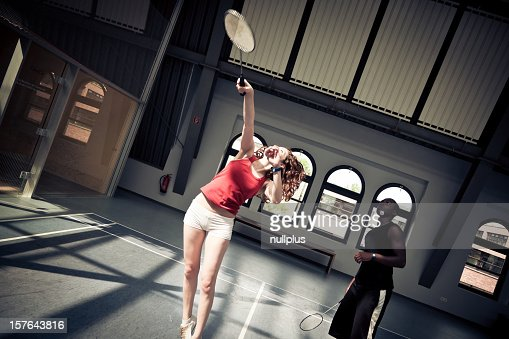 young people playing badminton at the gym