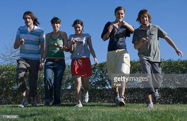 Young People Playing Egg and Spoon Race