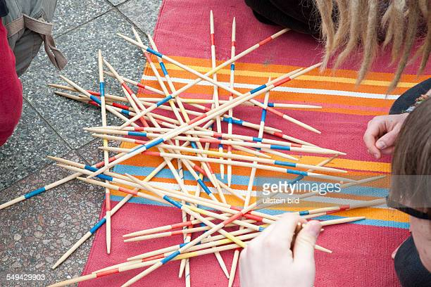 young people playing Mikado outside