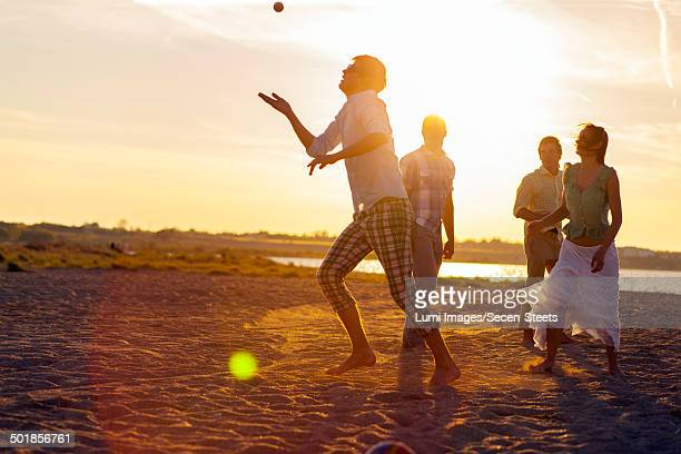 Young people playing on beach at sunset, Dalmatia, Croatia