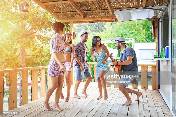Young people playing on veranda