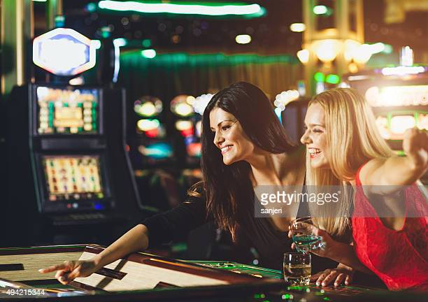 Young people playing roulette at the casino