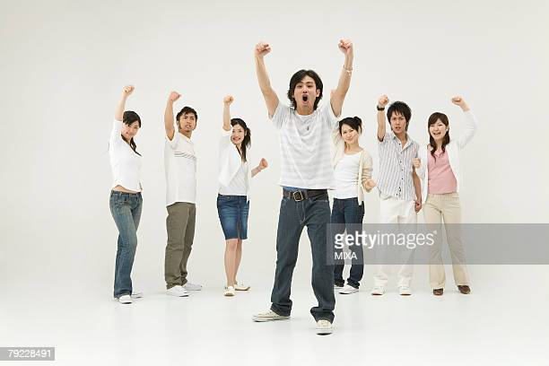 Young people raising hands