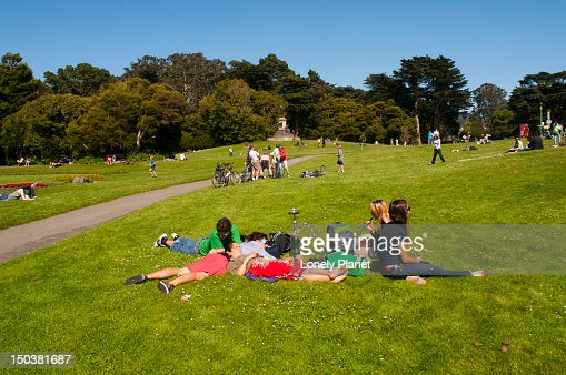 Young people relaxing in grass at Golden Gate Park. : Stock Photo