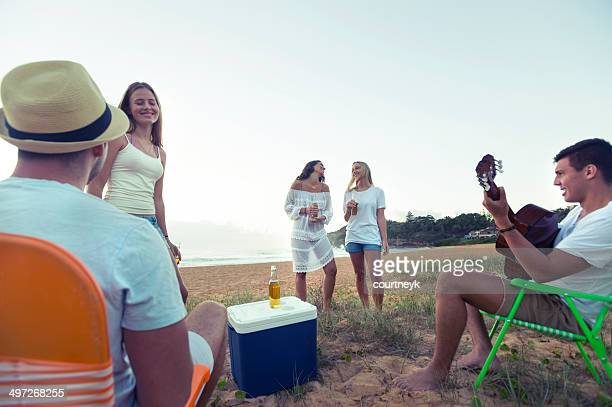 Young people relaxing on the beach