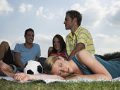 Young people resting in a field