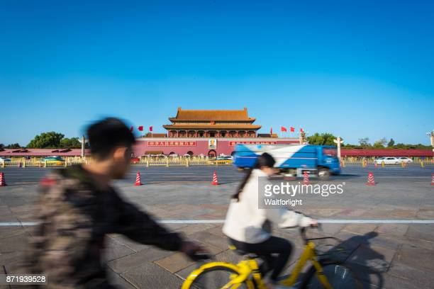 Young people ride bicycles through Tiananmen Square, Gate of Heavenly Peace,Beijing,China.