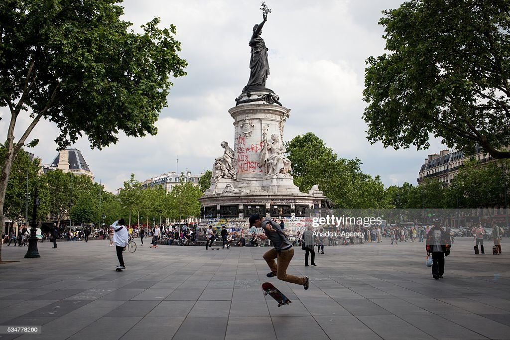 Young people ride skates on the Place of the Republique during the Global Debout meeting 'Nuit Debout' ('The Night awake' or Up all night') in Paris, France on May 27, 2016.