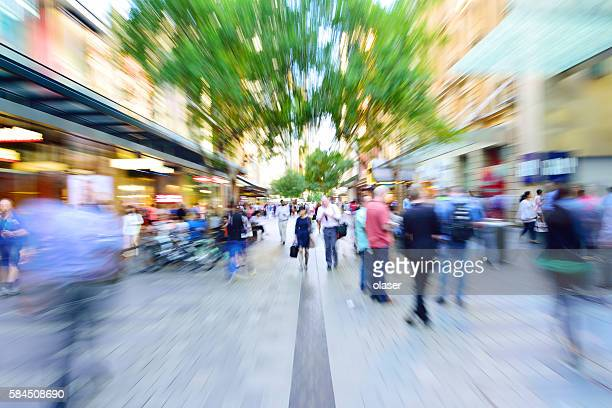 Young people shopping street, zoom and motion blur