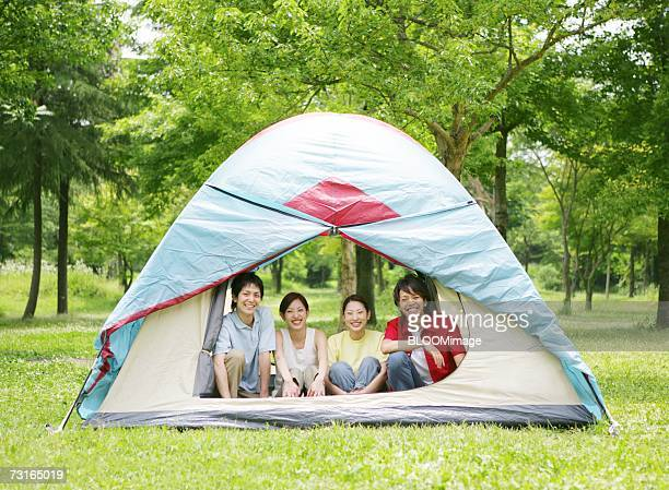 Young people smiling in tent