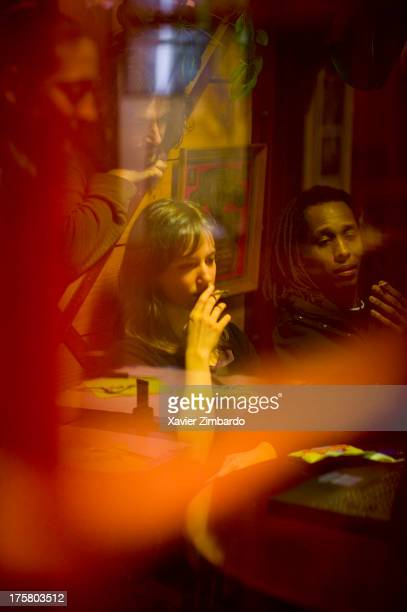 Young people smoking and looking at a computer in a bar at night on January 20 2005 in Sarcelles a Paris suburb France