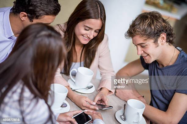 Young people social networking on a cell phone