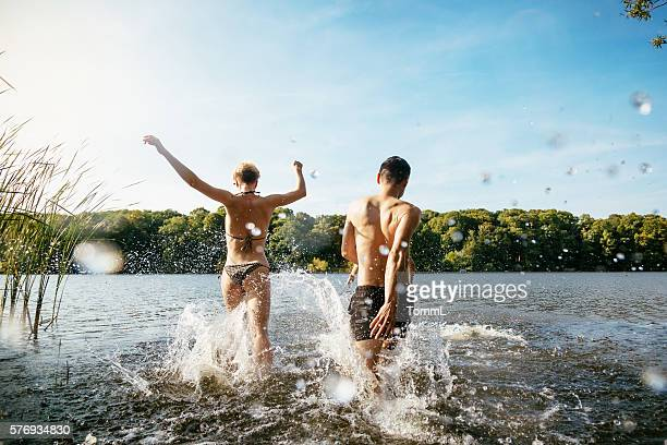 Young People Splashing In Lake