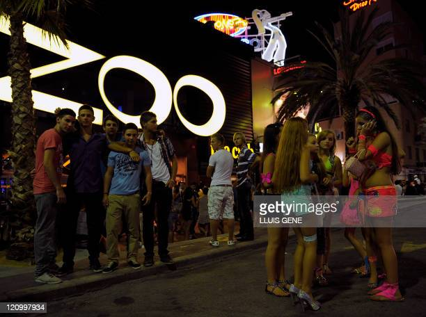 Young people stand infront of a nightclub on August 13 2011 in Lloret de Mar on Spain's northeastern Costa Brava Young people many of them tourists...