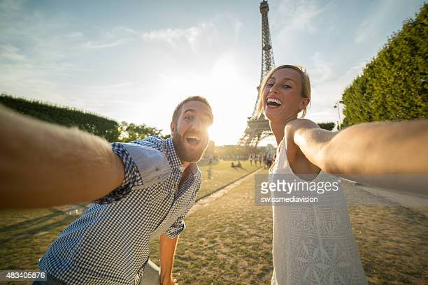 Young people taking selfie in front of Eiffel tower-Paris