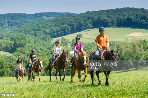 Young people trail riding in Hampstead Maryland USA