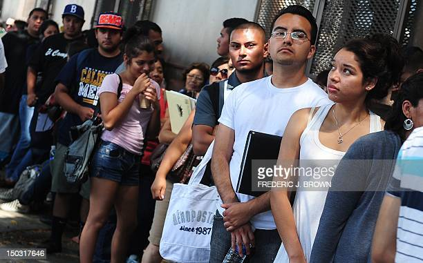 Young people wait in line to enter the office of The Coalition for Humane Immigrant Rights of Los Angeles on August 15 2012 in Los Angeles California...
