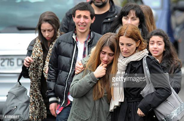 Young people walk away from the 'Ozar Hatorah' Jewish school on March 19 2012 in Toulouse southwestern France where four people were killed and two...