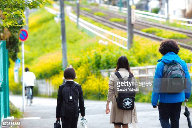young people walking on the slope beside the track