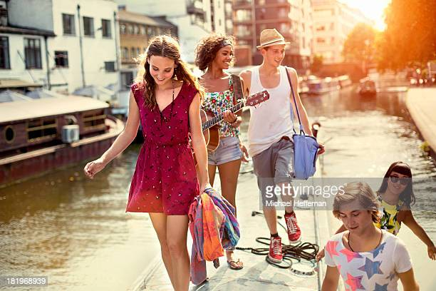 Young people walking on top of canal boat