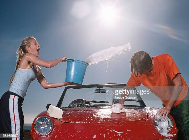 Young people washing car