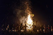TOPSHOT Young people wearing Belarus traditional clothes and wreaths dance around a bonfire as they celebrate the Ivan Kupala night an ancient...