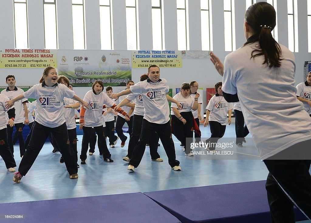Young people with Down Syndrome dance during an event marking the International Day of Down Syndrome in Bucharest March 21, 2013. March 21 aims to raise awareness among the population regarding people with Down syndrome and combat some wrong social perceptions, depriving these people of their right to an active life.