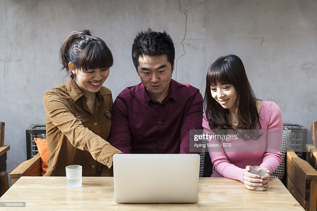 Young people with laptop : Stock Photo