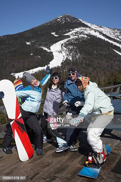 Young people with snowboards playing