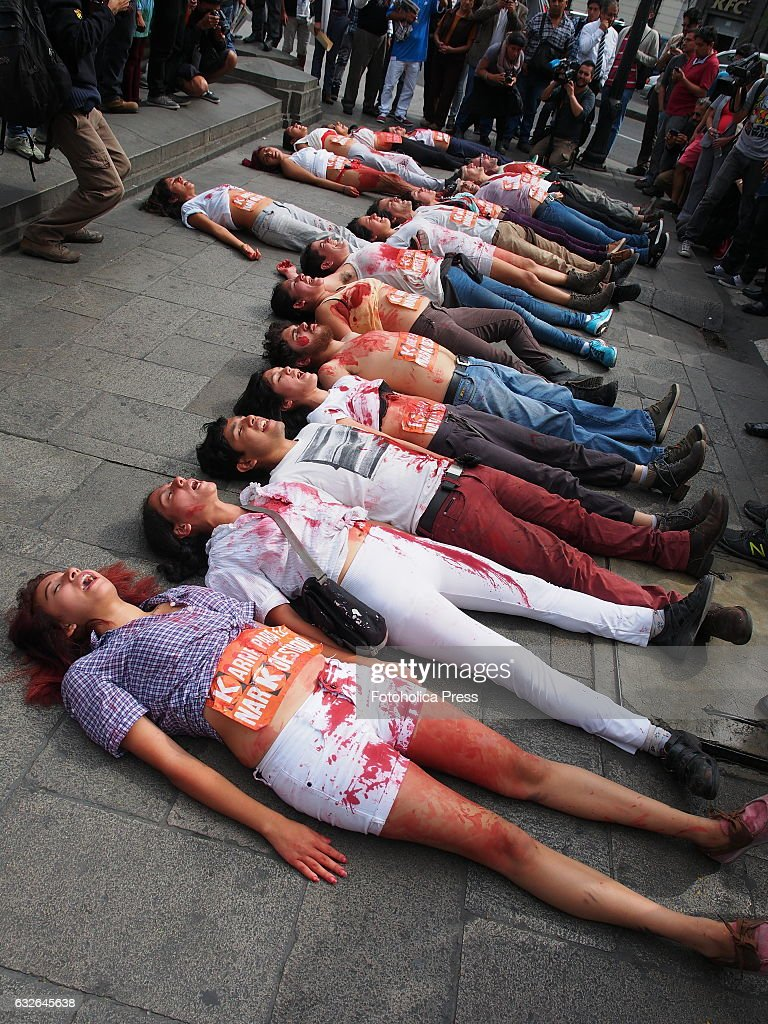 Nice Young People With Stained Bodies Lying On Floor. Dozens Of Young People  With Bodies Painted