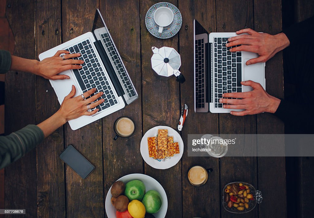 Young people working in the Paris outdoors co-working space : Stock Photo